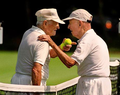 two elderly tennis players meeting at the net for a lively discussion. Exercise for elderly. Activities for elderly.