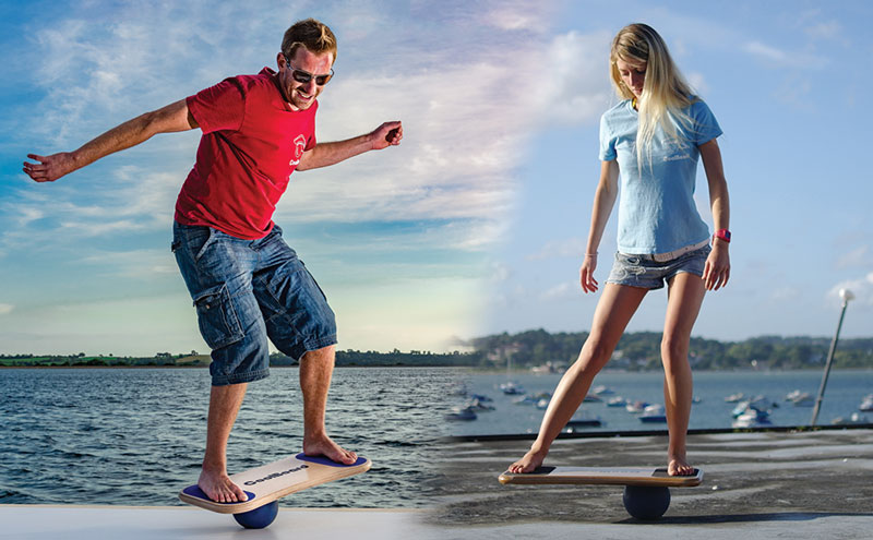 man enjoying dynamic balance training and woman using CoolBoard balance board on the ball